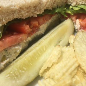 Heart-N-Soul Chicken Salad Sandwich with pickle and ruffles